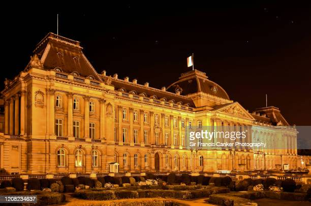 brussels royal palace illuminated at night in brussels, belgium - belgium stock pictures, royalty-free photos & images