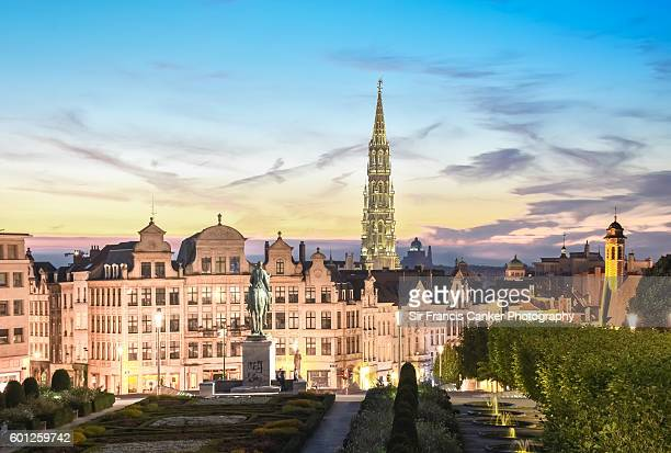 Brussels skyline at dusk with majestic City Hall bell tower in Gothic style illuminated with romantic sky, Brussels, Belgium