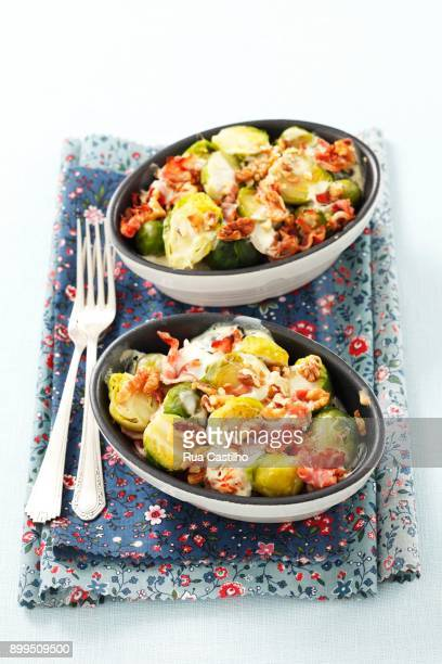 brussels sprouts baked with bacon, walnuts and cream - rua stock pictures, royalty-free photos & images