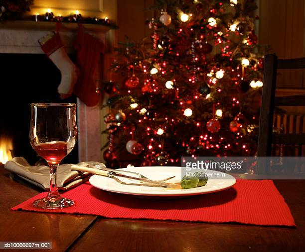 Brussels sprouts on empty plate, Christmas tree behind