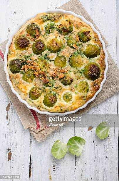 Brussels sprouts tart ready to eat on cloth and wood
