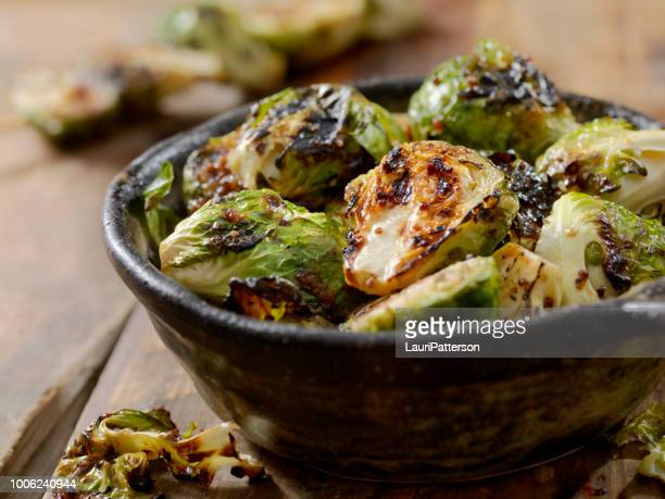 bbq brussels sprouts with grainy mustard, honey glaze - roasted stock pictures, royalty-free photos & images