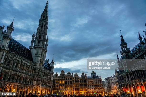 brussels town hall and the bread house in grand place - moody sky stock pictures, royalty-free photos & images