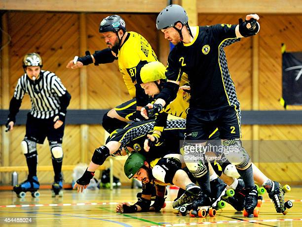 Brutal Delux of Panam Squad and Super Nashwan of Crash Test Brummies bout in the Men's European Cup roller derby tournament at Walker Activity Dome...