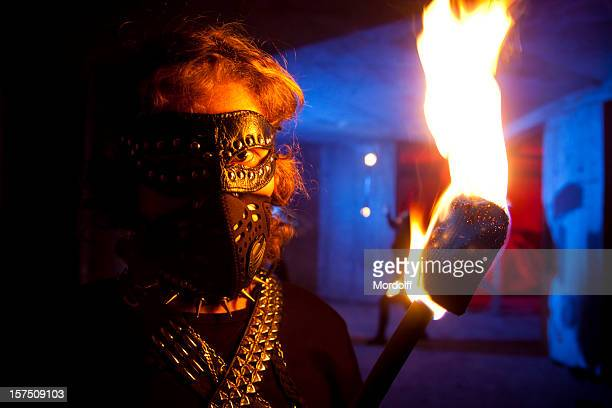 brutal man with torch in abandoned building - in flames i the mask stock pictures, royalty-free photos & images