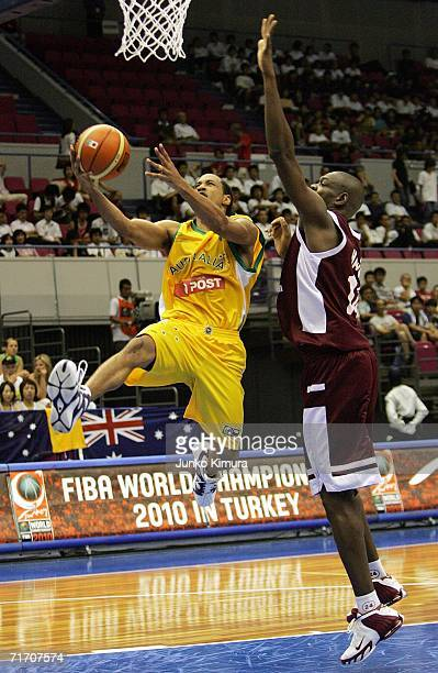J Bruton of Australia shoots against Qatar during the preliminary round of the 2006 FIBA World Championships on August 24 2006 in Hamamatsu Japan