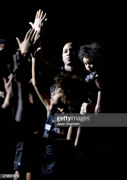 Bruton of the Breakers arrives on court for his final match with sons Rio Bruton and Roc before the round 23 NBL match between the New Zealand...