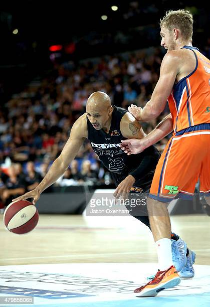 Bruton of the Breakers tries to scoot around Mitchell Young of the Taipans during the round 23 NBL match between the New Zealand Breakers and the...