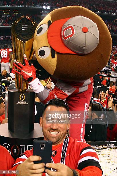 Brutus Buckeye celebrates with the trophy after defeating the Oregon Ducks 4220 in the College Football Playoff National Championship Game at ATT...