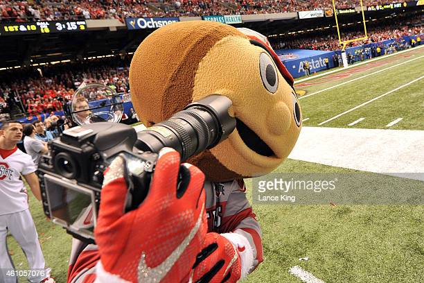 Brutus Buckeye the mascot of the Ohio State Buckeyes attempts to take a selfie during a game against the Alabama Crimson Tide during the Allstate...