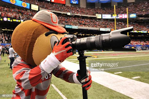 Brutus Buckeye the mascot of the Ohio State Buckeyes looks through a camera during a game against the Alabama Crimson Tide during the Allstate Sugar...