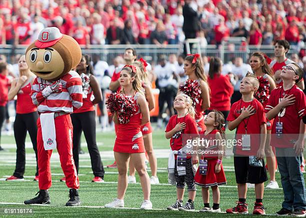 Brutus the Buckeye and some young Buckeye fans stand for the National Anthem prior to an NCAA football game between the Northwestern Wildcats and the...