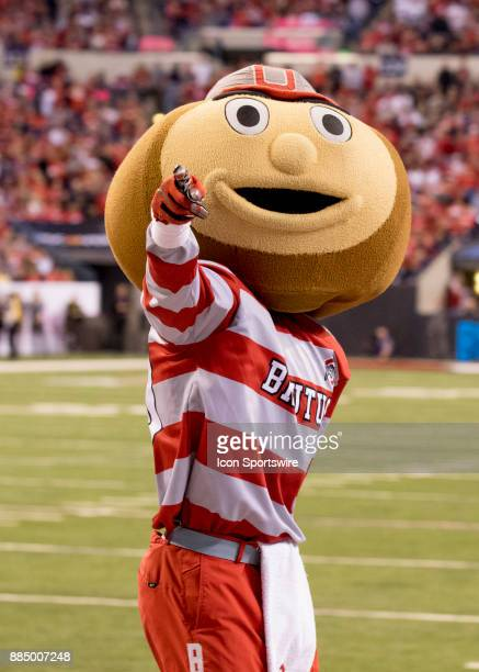 Brutus the Buckeye entertains fans during a TV time out during the Big 10 Championship Game between the Ohio State Buckeyes and the Wisconsin Badgers...