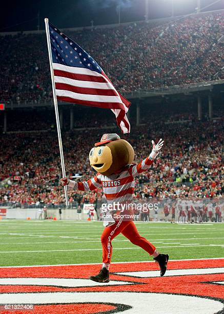 Brutus The Buckeye running with the American flag during the second quarter of the game against the Nebraska Cornhuskers on November 5 at the Ohio...