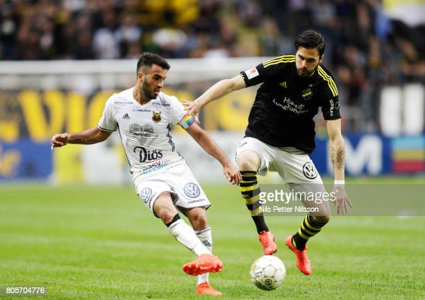 Brwa Nouri of Ostersunds FK and Denny Avdic of AIK competes for the ball during the Allsvenskan match between AIK and Ostersunds FK at Friends arena...