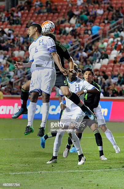 Bryan Acosta of Honduras heads the ball away from Erick Torres of Mexico in the second half of the final CONCACAF Olympic Qualifying match at Rio...