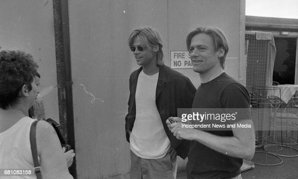 Bryan Adams and Brad Pitt sign autographs after the Concert at The Point Depot, Dublin, .
