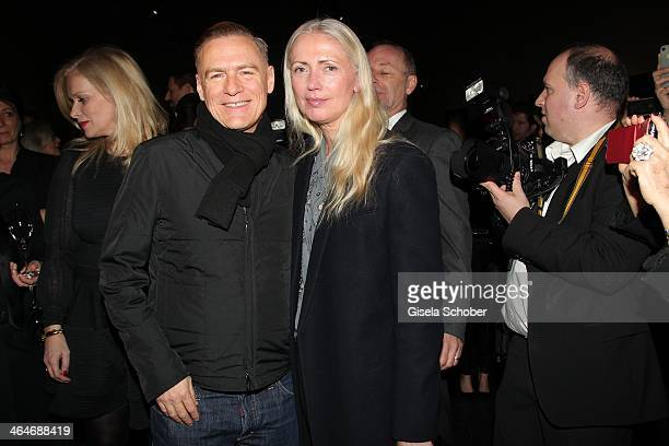 MUNICH GERMANY JANUARY Bryan Adams and Christiane Arp attend the presentation and vernissage of the calender 'THE ADAM BY BRYAN ADAMS' for Opel at...