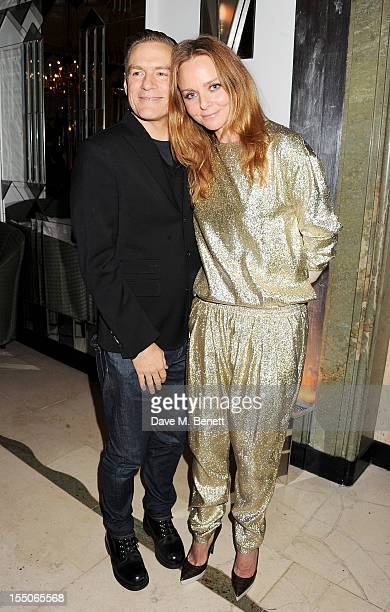 Bryan Adams and Stella McCartney attend the Harper's Bazaar Women of the Year Awards 2012 in association with Estee Lauder Harrods and Tiffany Co at...