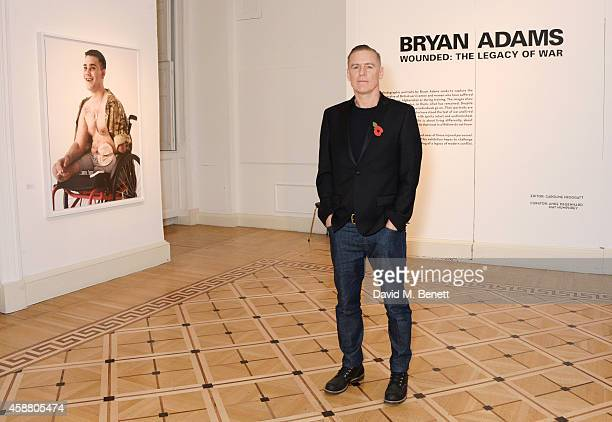 Bryan Adams attends the private view of 'Wounded The Legacy of War' at Somerset House on Remembrance Day November 11 2014 in London England The...