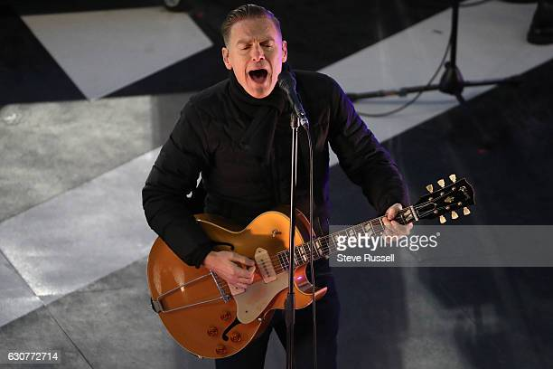 Bryan Adams entertains in the first intermission as the Toronto Maple Leafs play the Detroit Red Wings alumni in the Centennial Classic at Exhibition...