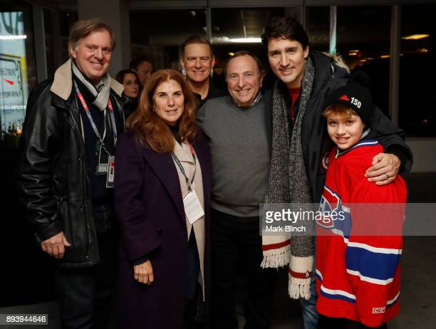 Bryan Adams Gary Bettman Justin Trudeau and Xavier Trudeau pose for a group photo prior to the 2017 Scotiabank NHL 100 Classic between the Montreal...