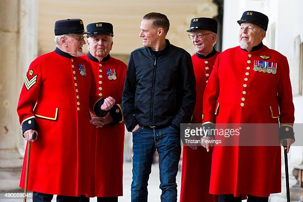 Bryan Adams meets with some Chelsea Pensioners after unveiling a plaque named in honour of his foundation 'The Bryan Adams Foundation' at Royal...