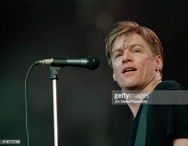 Bryan Adams performing on stage at Wembley Stadium in London on the 18th July 1992