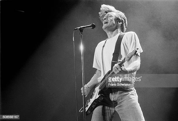Bryan Adams, vocal-guitar, performs at the Ahoy hal in Rotterdam, Netherlands on 13th November 1991.