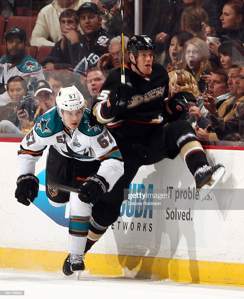 Bryan Allen #55 of the Anaheim Ducks collides with Tommy Wingels #57 of the San Jose Sharks on February 4, 2013 at Honda Center in Anaheim, California.