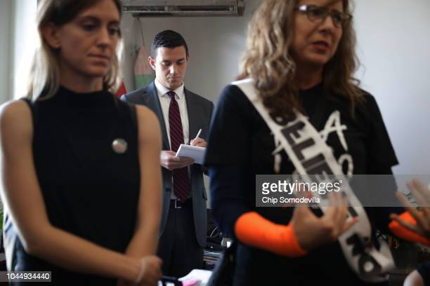 Bryan Allen staff assistant for Sen Susan Collins takes notes as sexual assault survivors tell their stories while demonstrating against the...