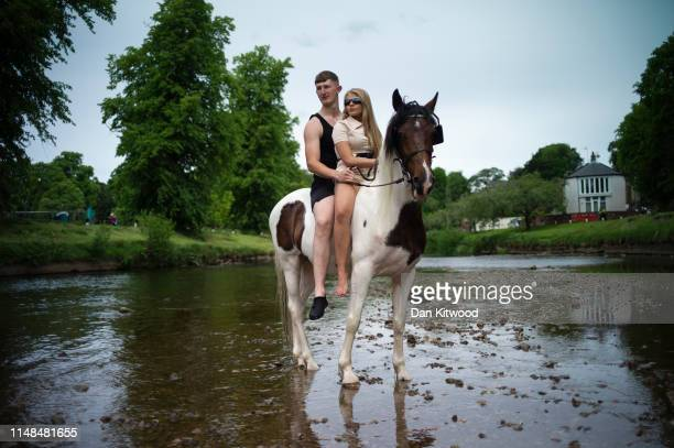 Bryan and cousin Katie stop to pose while sitting on their horse Lad during the annual Appleby Horse Fair on June 07, 2019 in Appleby-in-Westmorland,...