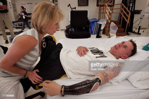 Bryan Anderson gets stretched by Kristin Valent during a physical therapy session at Walter Reed Army Medical Center August 18 2006 in Washington DC...