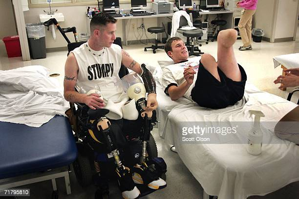 Bryan Anderson watches as Neil Duncan goes through physical therapy at Walter Reed Army Medical Center August 18 2006 in Washington DC Duncan an Army...