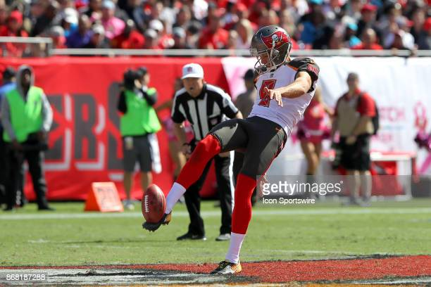 Bryan Anger of the Bucs shows off his perfect textbook style for a punt that in theory will pin the returning team inside the 10 yard line during the...