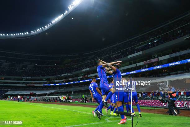 Bryan Angulo of Cruz Azul celebrates with teammates after scoring the first goal of his team during the quarterfinals second leg match between Cruz...