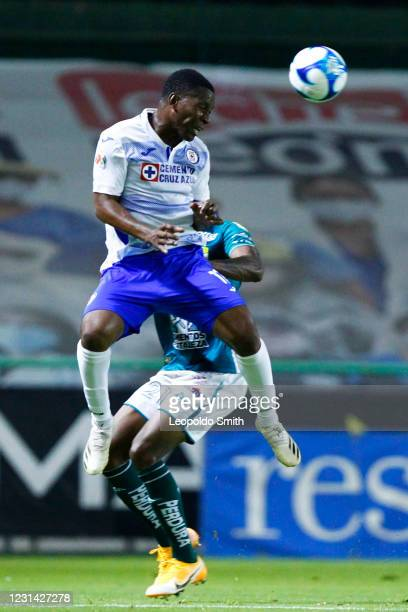 Bryan Angulo of Cruz Azul jumps for the ball with Jaine Barreiro of Leon during the 8th round match between Leon and Cruz Azul as part of the Torneo...