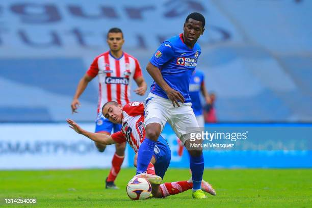 Bryan Angulo of Cruz Azul struggles for the ball against David Rodriguez of Atletico San Luis during the 16th round match between Cruz Azul and...
