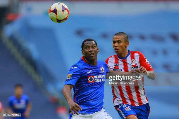 Bryan Angulo of Cruz Azul struggles for the ball against Luis Ramirez of Atletico San Luis during the 16th round match between Cruz Azul and Atletico...