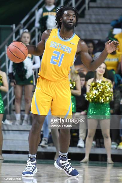 Bryan Assie of the Southern University Jaguars dribbles the ball during a college basketball game against the George Mason Patriots at the Eagle Bank...