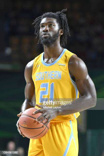 Bryan Assie of the Southern University Jaguars takes a foul shot during a college basketball game against the George Mason Patriots at the Eagle Bank...