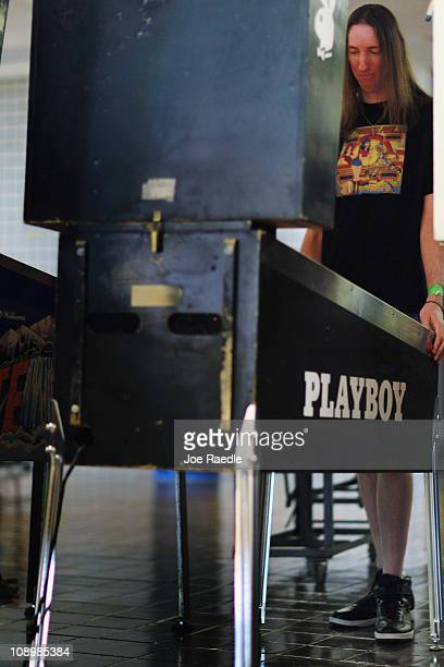 Bryan Balkie plays a pinball machine during The Florida Arcade Pinball Expo at the Dania JaiAlai Sports Entertainment Complex on February 10 2011 in...