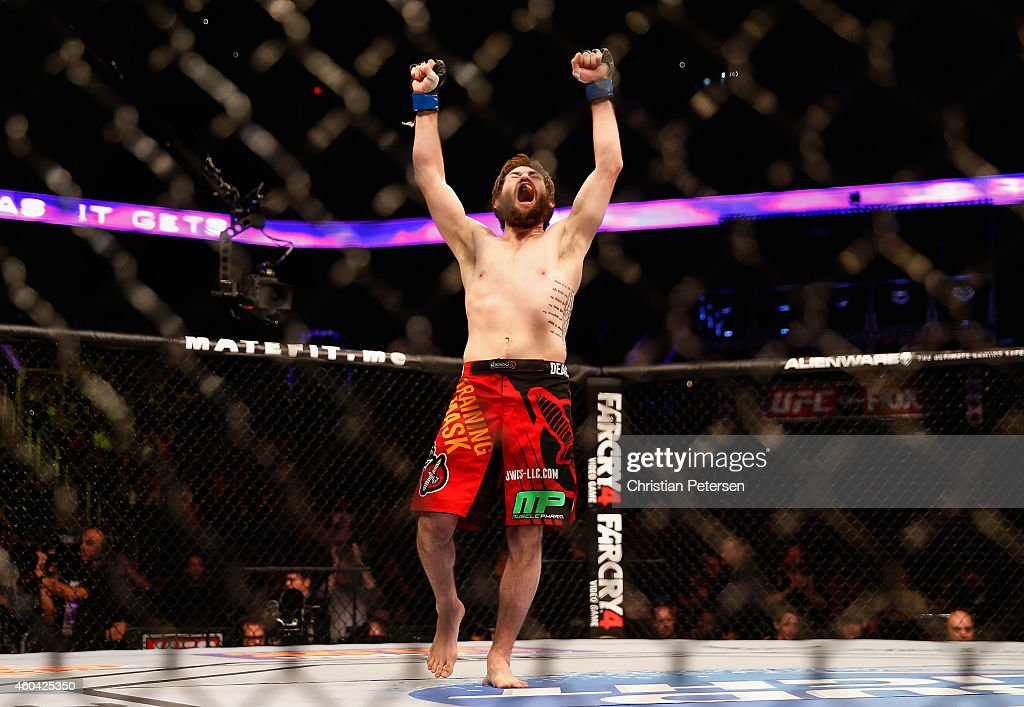 Bryan Barberena celebrates after defeating Joe Ellenberger (not pictured) during their lightweight bout in the UFC Fight Night event at the at U.S. Airways Center on December 13, 2014 in Phoenix, Arizona.