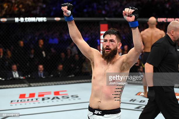 Bryan Barberena celebrates after defeating Warlley Alves of Brazil in their middleweight bout during the UFC 198 event at Arena da Baixada stadium on...