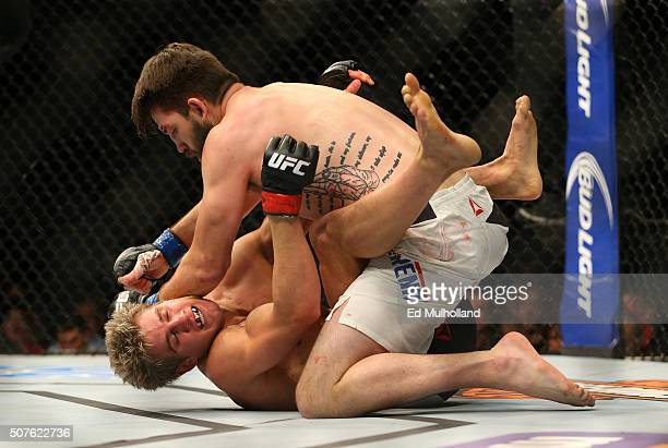 Bryan Barberena elbows Sage Northcutt in their welterweight bout during the UFC Fight Night event at the Prudential Center on January 30 2016 in...