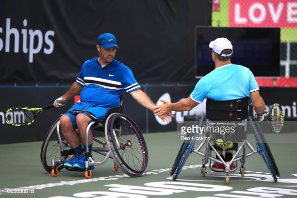 Bryan Barten and David Wagner of The USA celebrate winning a point during the final of the men's quad doubles against Ymanitu Silva of Brazil and...