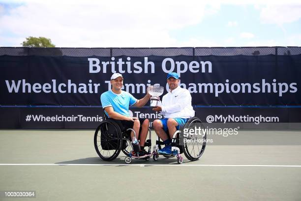 Bryan Barten and David Wagner of The USA pose for a picture with the trophy after winning the final of the men's quad doubles against Ymanitu Silva...