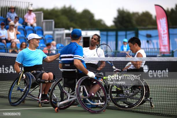 Bryan Barten and David Wagner of The USA shake hands with Ymanitu Silva of Brazil and Shota Kawano of Japan following the men's quad final on day...
