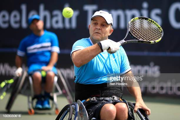 Bryan Barten of The USA plays a backhand during the final of the men's quad doubles against Ymanitu Silva of Brazil and Shota Kawano of Japan on day...