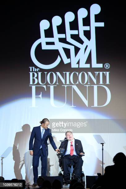 Bryan Bedder and Marc Buoniconti speak on stage during the 33rd Annual Great Sports Legends Dinner which raised millions of dollars for the...